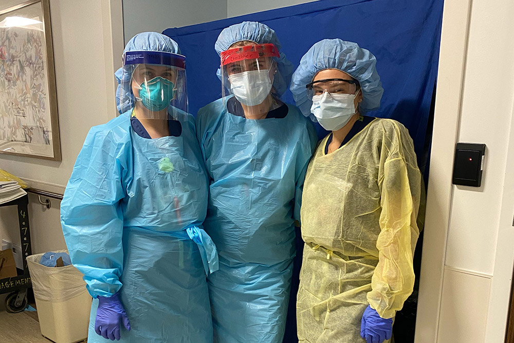 UVA Nursing grad Amelia Conner, BSN 2018, wearing personal protective equipment (PPE) with Northwell Hospital colleagues during 2020 COVID-19 pandemic