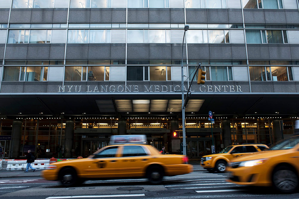Taxis drive past entrance to NYU Langone Medical Center