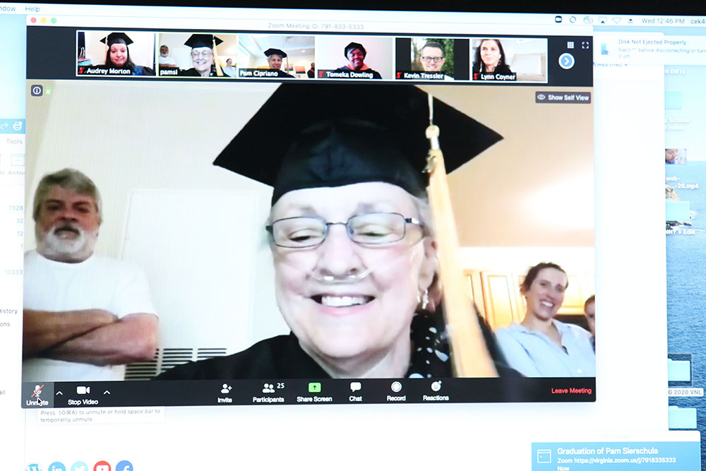 UVA Nursing student Pam Sierschula in cap and gown during online graduation ceremony